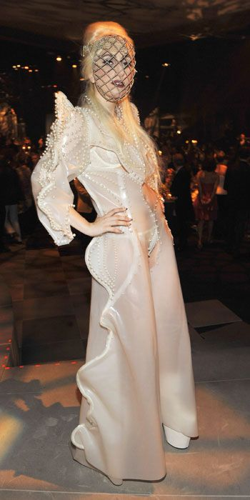 LOOK YOUR BEST THIS SUMMER For Elton John's annual White Tie and Tiara Ball, Gaga chose a pearl-embellished latex gown by Francesco Scognamiglio.