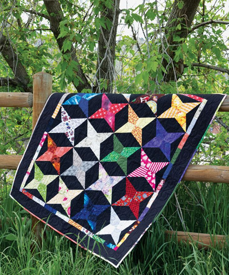 Interesting shapes make this design look difficult, but this scrappy throw quilt is actually easy to create.