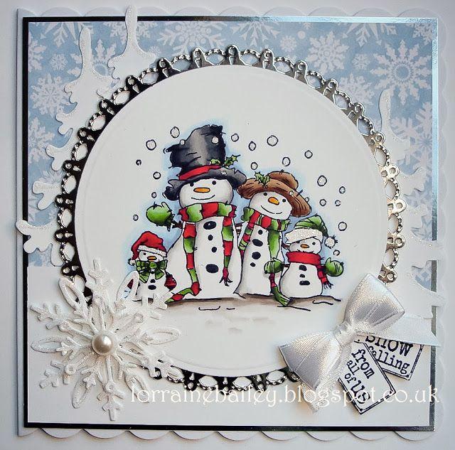 Handmade snowman family card created by Lorraine Bailey. Many interesting embellishments. #Snowman, #Snowmen, #SnowmanCard, #SnowmenCard, #SnowFamily, #SnowFamilyCard, #HandmadeCard, #HomemadeCard, #HandcraftedCard, #Card, #CardIdea, #Winter, #Wintertime, #CardForWinter, #CardForWintertime, #HandmadeWinterCard, #WinterCard, #HandmadeWintertimeCard, #WintertimeCard