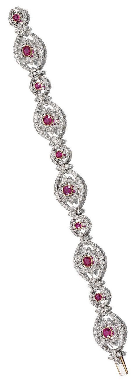 A BELLE EPOQUE RUBY AND DIAMOND BRACELET/COLLIER DE CHIEN, CIRCA 1910. Designed as a series of foliate openwork links, millegrain-set with circular- and single-cut diamonds, centring on a similarly-set cushion-shaped and circular-cut ruby respectively, with quatrefoil connecting links, may be converted into a collier de chien with an additional diamond-set chain accompanying this lot, numbered, French assay marks.