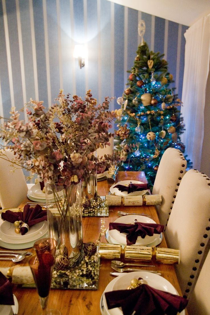 This beautiful show home at Wickhurst Green, Broadbridge Heath has been decorated using gold and burgundy tones. The Christmas tree lights up the room and the place settings are both stylish and seasonal.