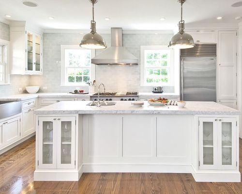 """Less is more in this traditional style kitchen with minimal upper cabinets allowing the space to feel light and open.  Design features include Grabill custom cabinetry painted with """"white dove""""."""