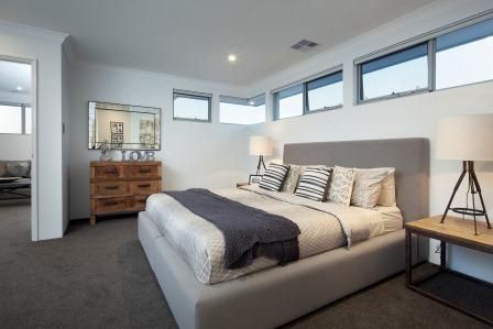 A private lounge area off the main bedroom needs to be comfortable and inviting. A couch and a television isn't enough to encourage use of a retreat. Music, wine, books and photo albums can make this an intimate space for a couple.