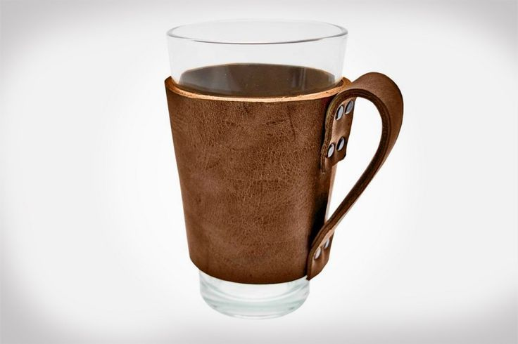 The Hide & Drink Leather Pint Sleeve is hand cut, sewn and fire branded using 100% soft genuine leather cowhide. Its handle makes it easy to carry your beverage