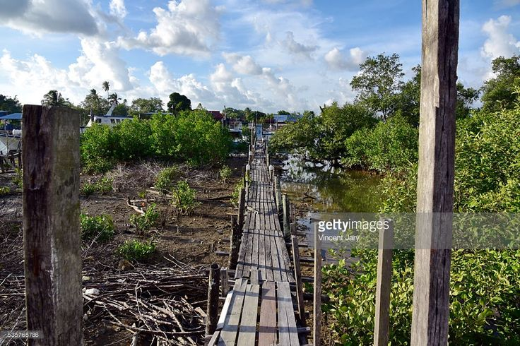 Wooden bridge crossing across the Mersing river at low tide, Mersing, #Malaysia, Asia. #getty #gettyimages #travel #mersing #bridge #photo #photography #www.vincent-jary.fr
