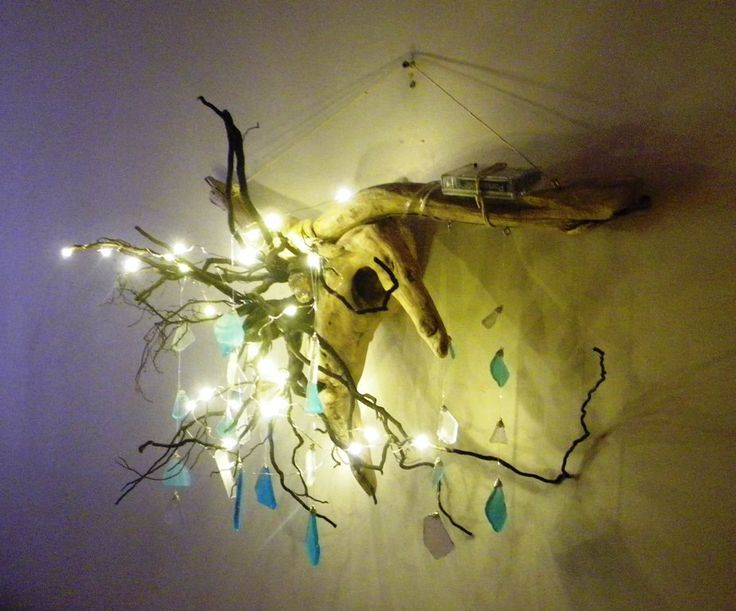 Driftwood tree root chandelier with led fairy lights and a sea glass mobile battery operated by BearlyRusticCabin on Etsy