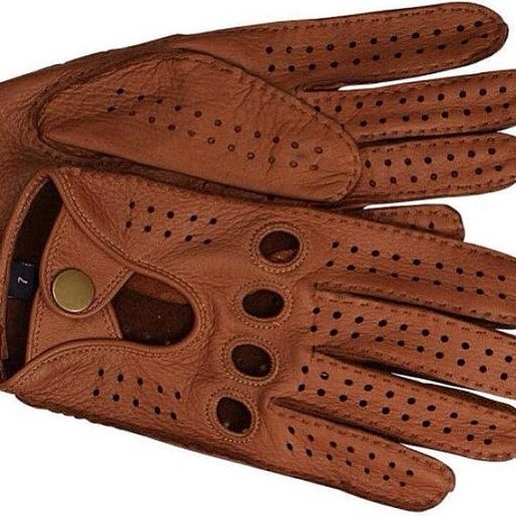 Glamour driving gloves for men.  Deerskin Leather gloves for Driving  Men's driving gloves made with fine deerskin leather which makes them extremely soft and an ideal leather for driving gloves. These driving gloves fit close to the hands offering better grip whilst protecting the hands. Driving gloves are a great way of providing extra grip whilst driving and also effective in reducing vibration.    Color: Dark Brown  Size relates to the circumference around the knuckles of the dominant…