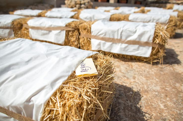 Hay bale seating reserved for the VIP's. Sourced from the local farmer and wrapped in soft material with hessian ribbon