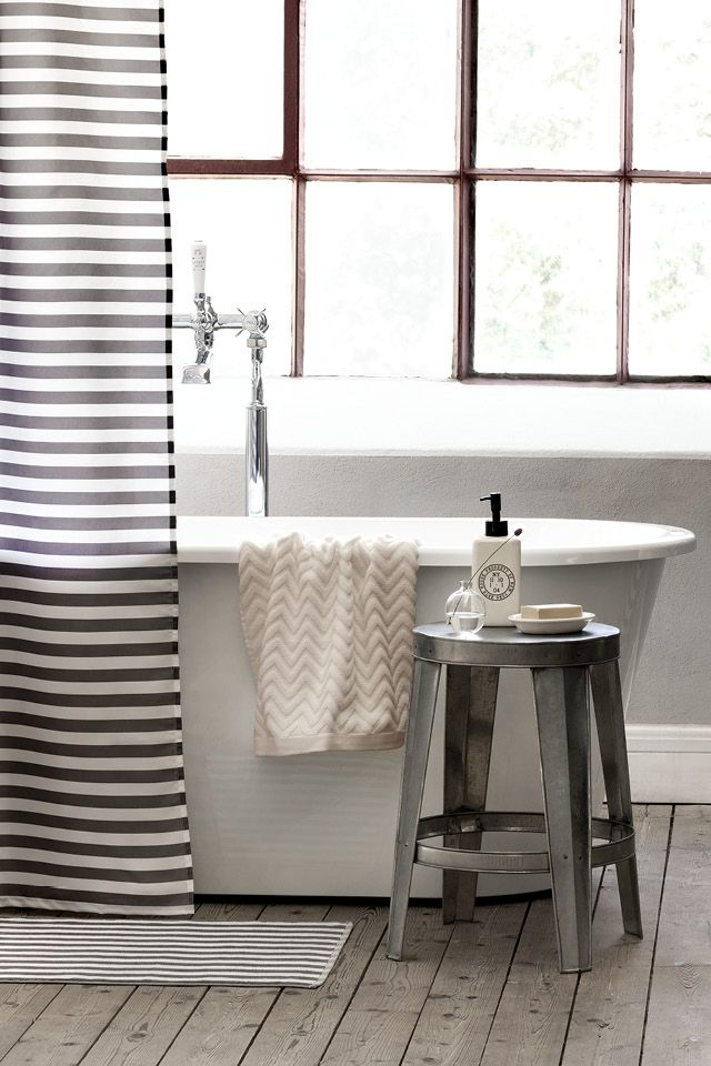 Shower curtain and dark wood