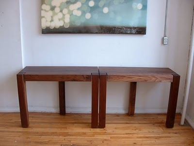 Two consloes snap together with mighty magnets to form an elegant dinning table for four. Easy to knock off.