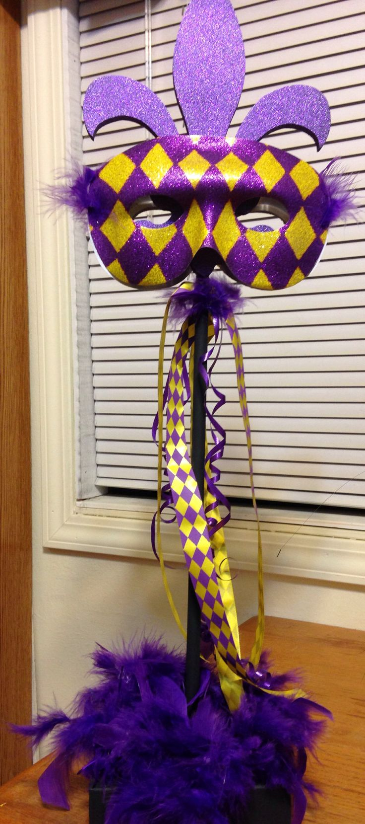 Mardi Gras centerpiece for 2014 work party.   Dad made the stands (Fleur de lys topper from Michaels). Mom and I designed the theme for each centerpiece.