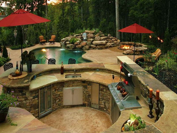 Rustic Patio with exterior stone floors, Fire pit, Fountain, Outdoor kitchen