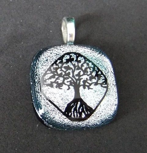 Ash Cremation Pendant for your pet or loved ones ashes.  This tree of life pendant comes in a variety of beautiful colors.  Your pet or loved one's ashes are seen from the back of the pendant by  addicted2glassfusion.artfire.com
