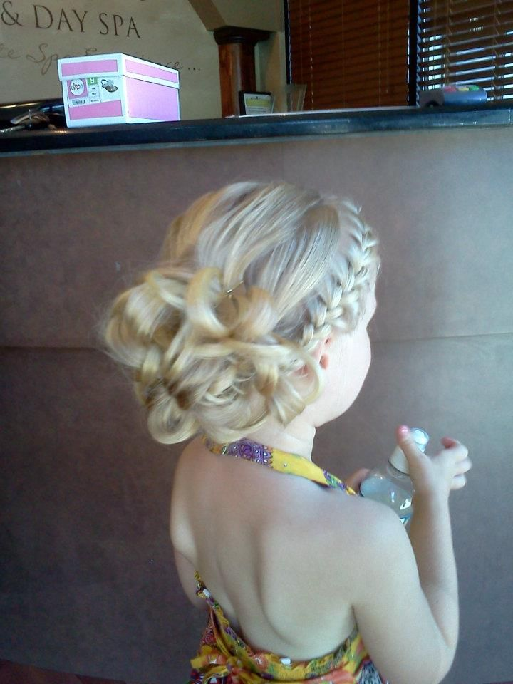 """Flower girl or bridesmaid hair...side french braid back. Depending on hair texture, the """"bun"""" could be a bunch of curls pinned for a more sleek look, or keep loose like this. Simple and pretty."""