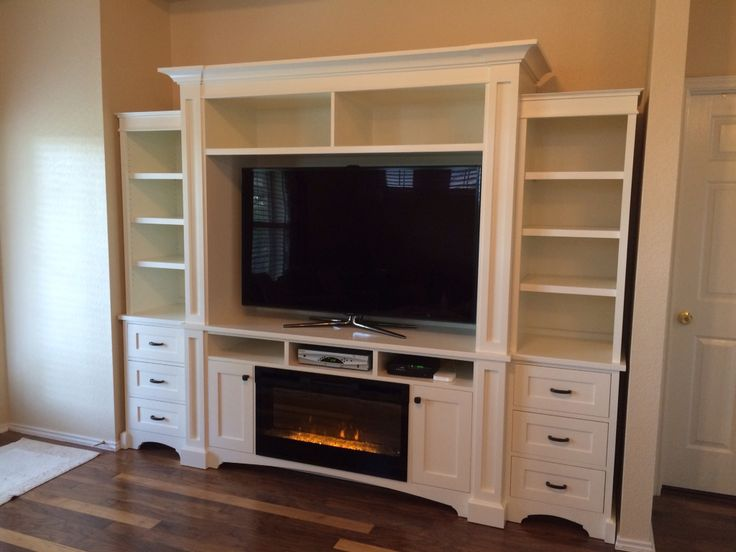 My design, carpenter built.  Entertainment center with built in electric fireplace. #entertainmentcenter #electric #fireplace