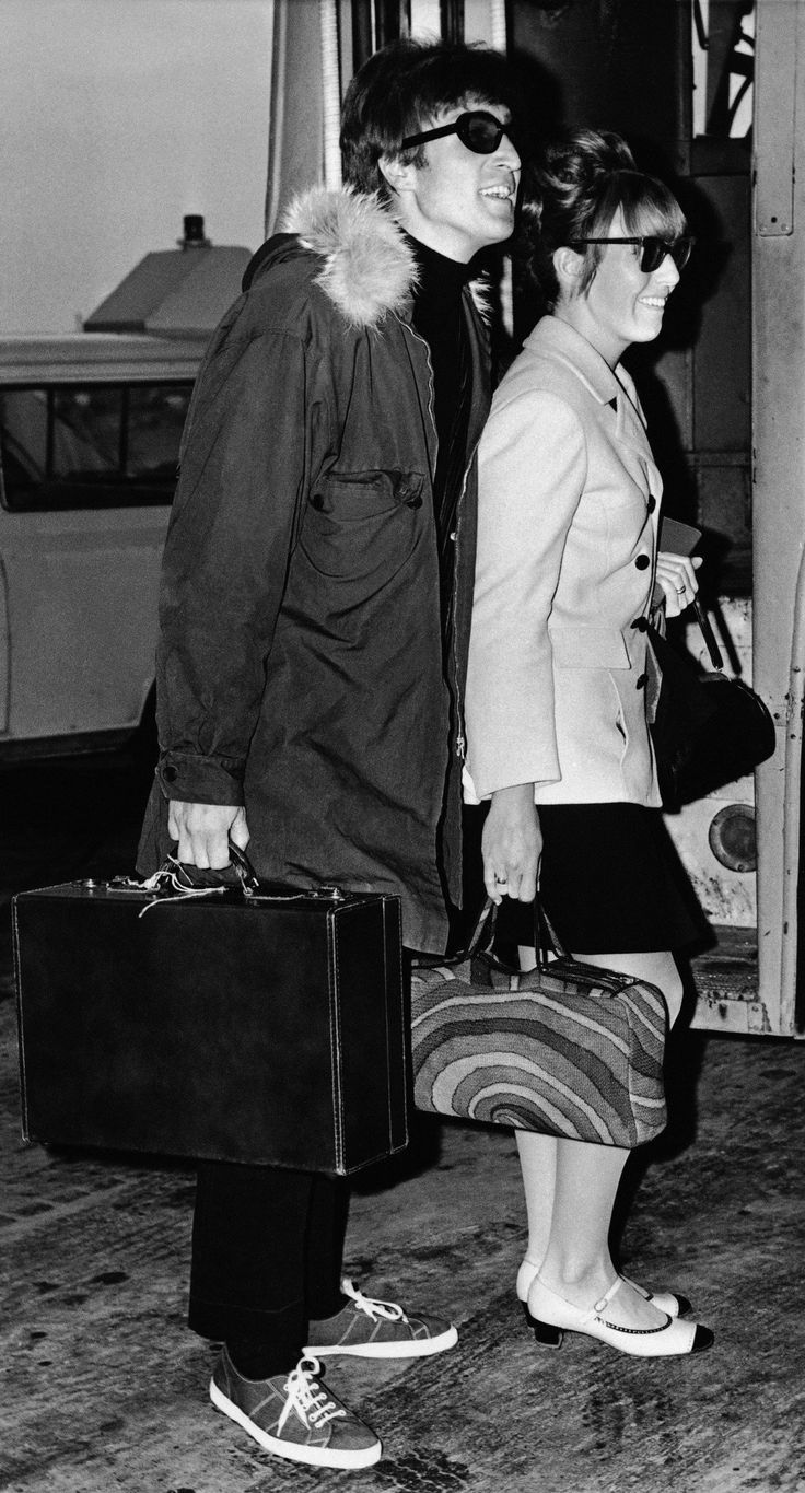 "John Lennon and his wife Cynthia are seen carrying their bags at Heathrow Airport-London after their arrival November 2, 1966 from Madrid, Spain. John Lennon has been in Madrid filming scenes for the new movie, ""How I Won the War"" in which he stars. (AP Photo/Victor Boynton)"