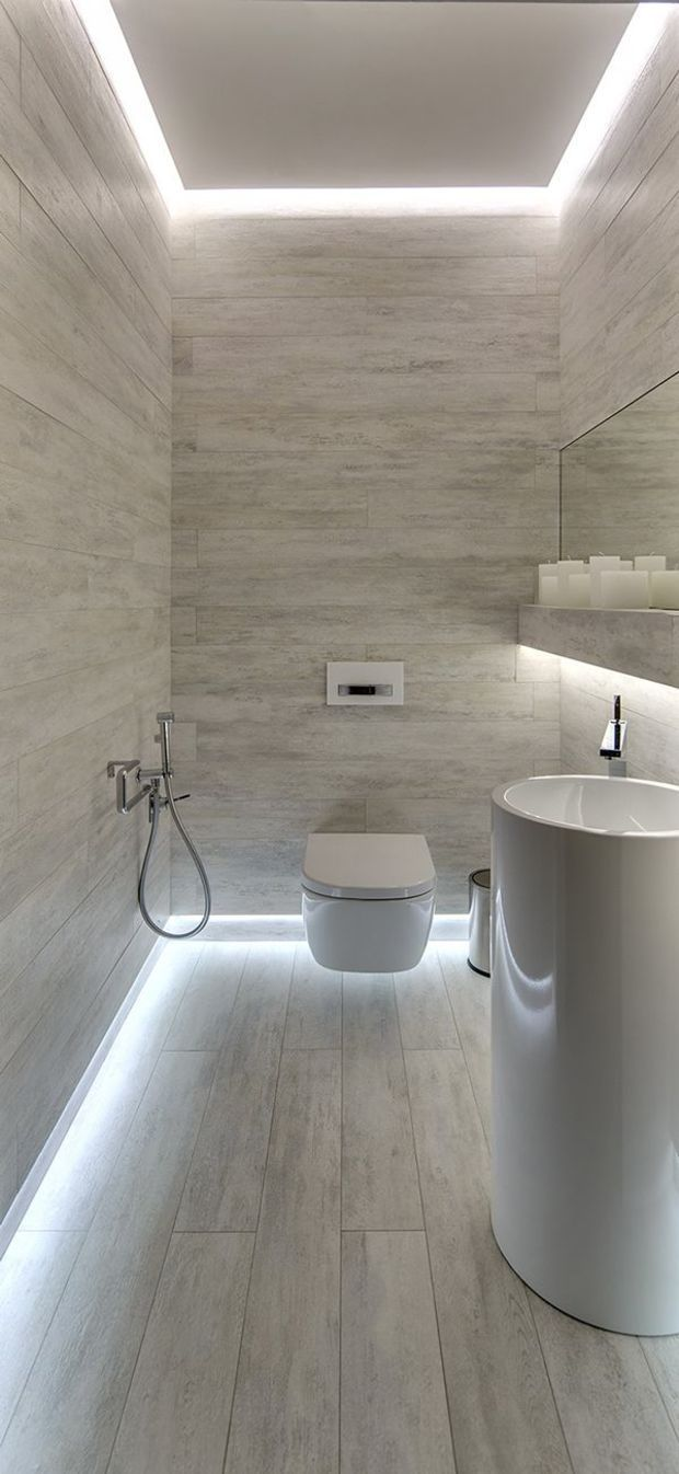 Monotone can be luxurious. Here the outline of the floor with lighting adds a touch of tech that's practical for any guest bathroom.