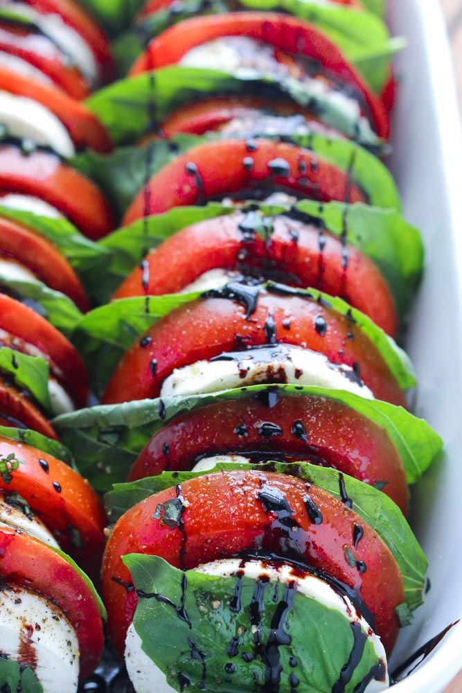 Best classic caprese salad with juicy tomatoes, fresh mozzarella and basil, drizzled with homemade sweet balsamic reduction. Easy appetizer or side dish.