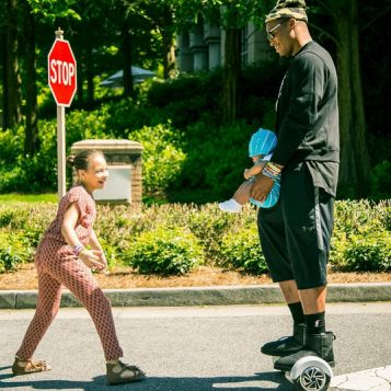 Cam Newton with son Chosen and girlfriend's daughter