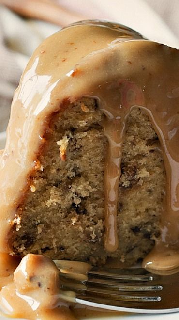 Toffee Pecan Bundt Cake with Caramel Drizzle _ This cake delivers on so many levels! A moist, sweet brown sugar cake is full of toffee bits & chopped pecans. Then – the cake is covered in a rich, sweet caramel drizzle that is perfection!