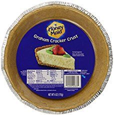 I love cheesecake! It is hands down my very favorite dessert! I just love the rich and creamy taste and texture so much that I can't get enough of it. In anticipation of Valentine's Day, which is right around the corner, I'm going to show you how to make Strawberry Swirl Cheesecake! You'll start by making a graham cracker crust. Mix together your butter, sugar, and graham crackers and then press the crumb mix into the bottom of your springform pan. Pop your crust into the oven...