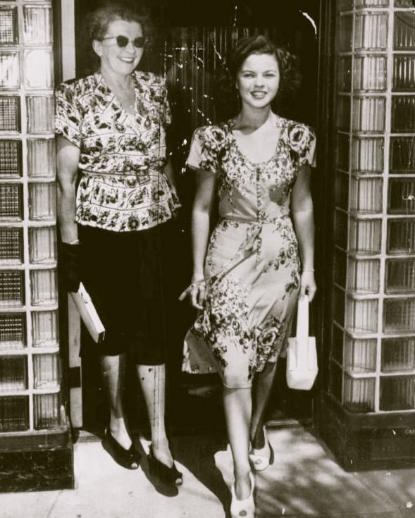 Shirley Temple shopping for a wedding dress with her mother, 1945 ~ fashion style photo print ad movie star 40s floral print dress day