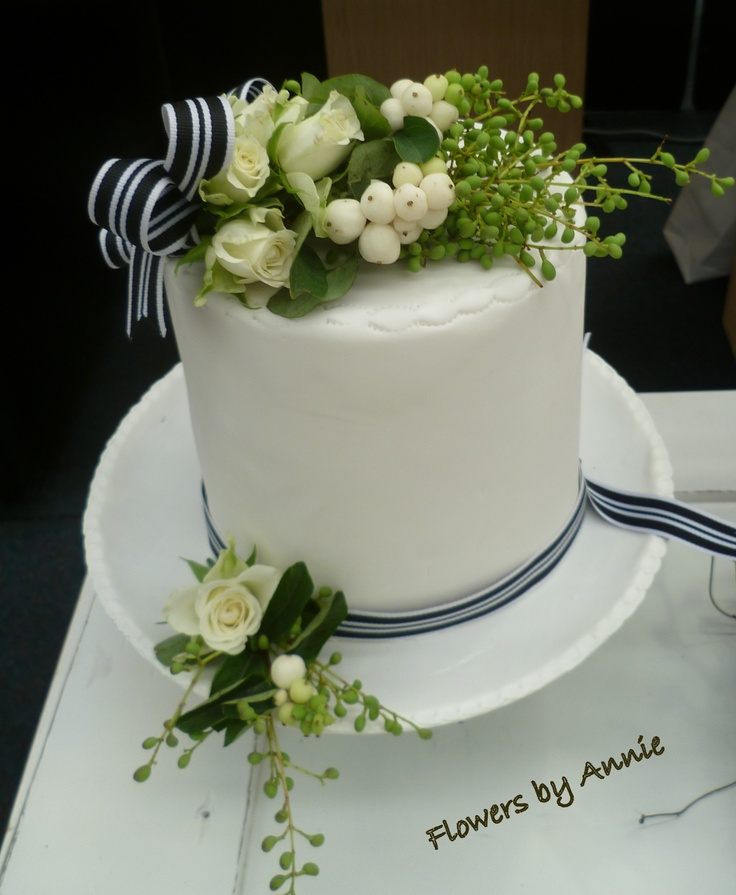 Decorate a wedding cake with real flowers.