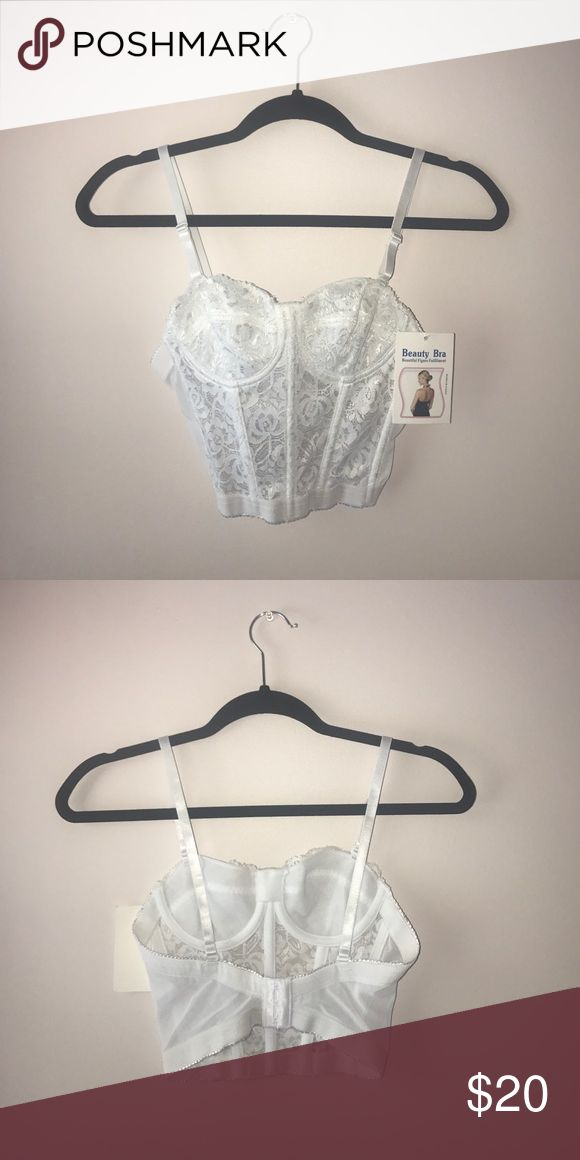 NEW! White lace Nasty Gal bustier corset size 32A NEW! White lace Nasty Gal bustier corset size 32A never been worn! Still has the tag on. Nasty Gal Intimates & Sleepwear Bras