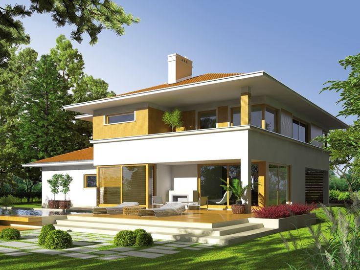 Strefa dzienna połączona jest z częściowo zadaszonymi tarasami, które harmonijnie łączą ogród z wnętrzem domu.