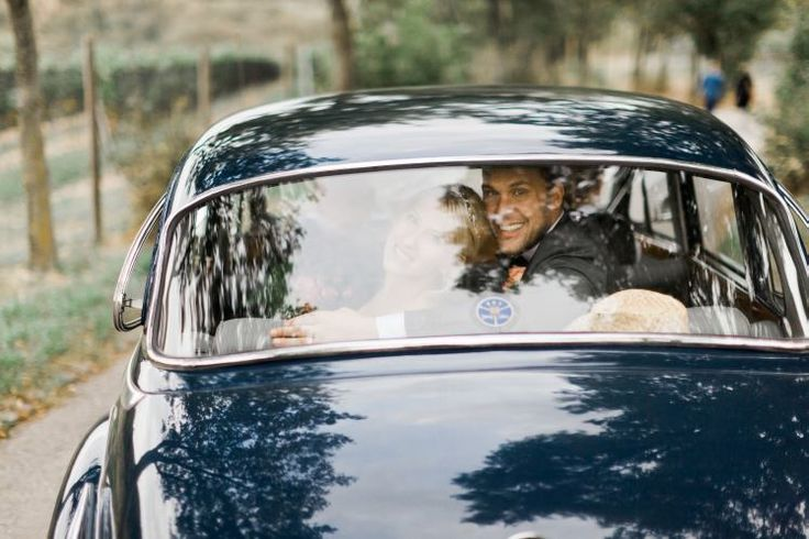 happy couple in the olt timer car - BMW