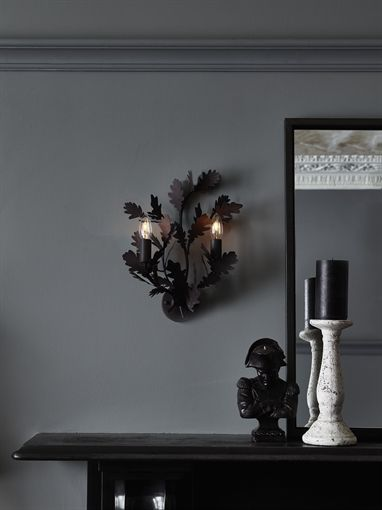 An antiqued, rustic candlestick with a classic slim profile