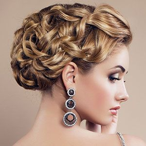 Updos with intricate spirals and curls for a romantic look!