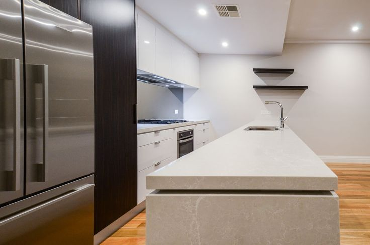 Complete Kitchens featuring Caesarstone Alpine Mist island bench top.