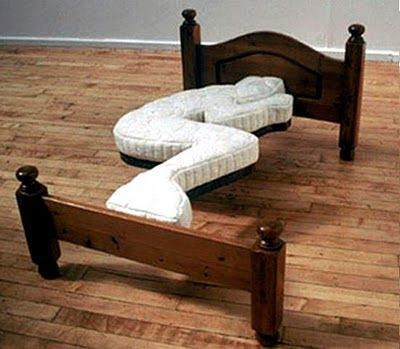 Unusual Bed: It looks like this is designed just for a specific sleeping position.