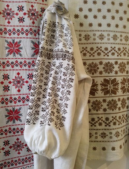 Different embroidery patterns on a women's shirt and festive towels. Poltava region of Ukraine (central part of the country). The shirt and the towel at the right are embroidered with the threads dyed by the oak bark