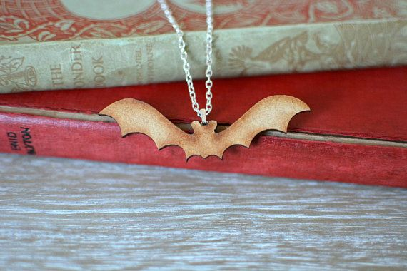 Wooden Bat Necklace. A delightful handmade bat necklace, with silver plated chain and findings.   https://www.etsy.com/uk/listing/228913196/wooden-bat-necklace-natural-laser-cut?ref=shop_home_active_5