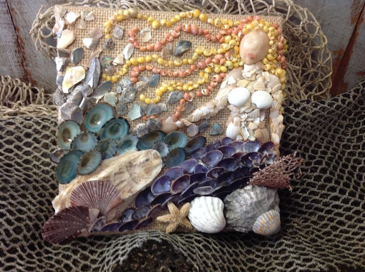 Mermaid Seashell Wall Collage Handmade in Ventura, CA. The seashells on this Wall Art are very colorful with the little tiny orange and yellow nerite shells aka snail shells being the Mermaid's hair.