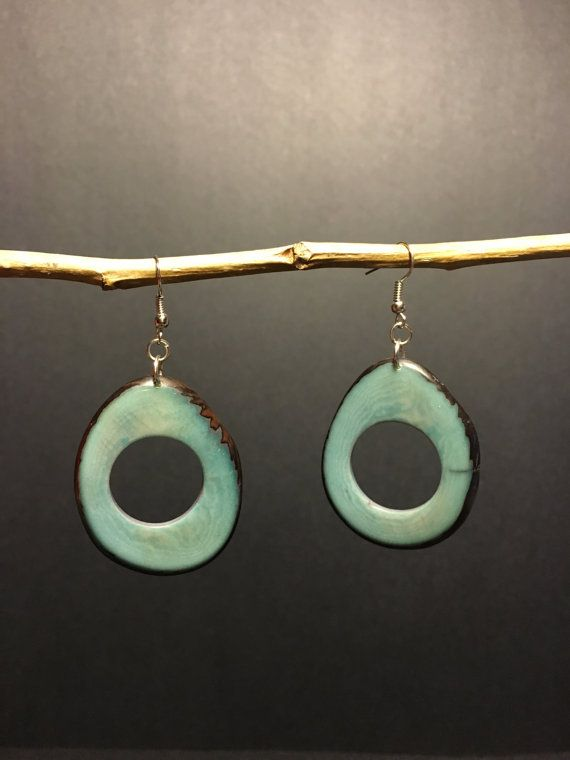 These tagua nut earrings were handmade in Ecuador by girls recovering from trafficking.  All proceeds go back to them!