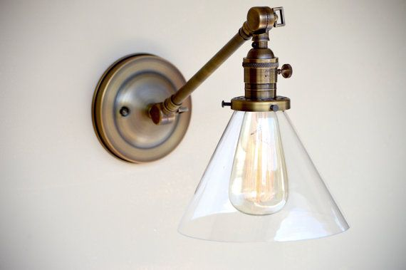 Sconce lighting with Glass Cone Shade Adjustable Arm Fixture  Here is a beautiful wall sconce with a 7 glass cone shade that can be adjusted easily with the 2 strong hinged joints. These metal shades match great with my pendant lighting which you can purchase in the same style. This wall sconce is pictured with an antique style edison bulb and is available for sale in my shop. All my lighting comes with all the mounting hardware necessary to be easily installed  This fixture has a 11 arm and…