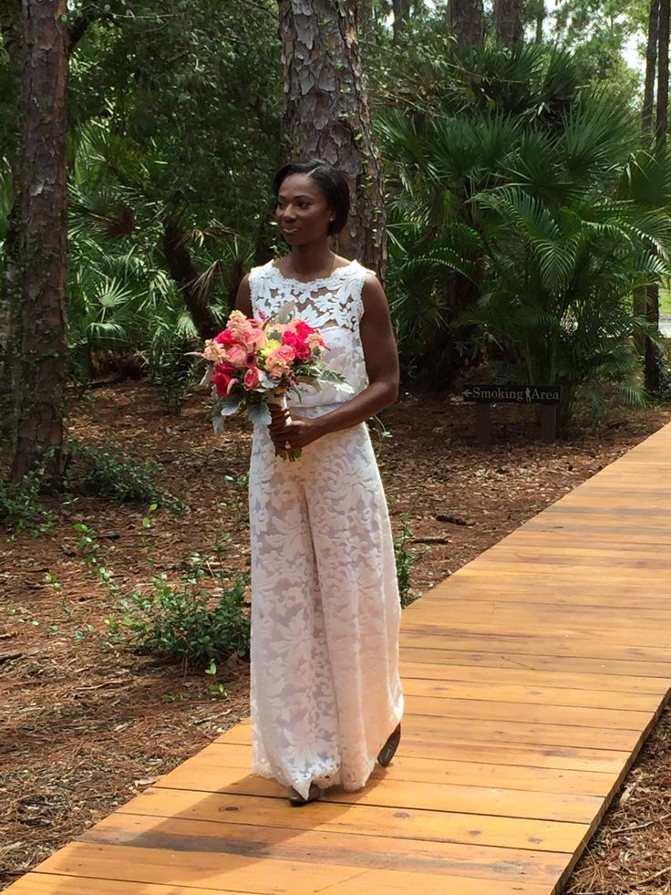 Our beautiful bride on the boardwalk at Cielo Blu Barn. The boardwalk starts at the ADA parking area and goes in between garden and pergola.