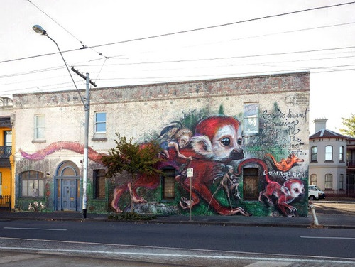 "Herakut is currently in Melbourne, Australia where they just completed the ninth mural of their Giant Storybook Project.  The German duo delivers yet another brilliant piece which reads ""So she dreamt of running away with monkeys. The most Curious just tended to be the most courageous.""  If you are in the neighbourhood, this new piece can be seen in Fitzroy at: 639 Brunswick St Fitzroy North VIC 3068, Australia."