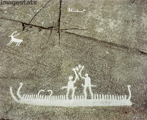 Petroglyph depicting two people with axes standing in a boat. Bohuslan, Sweden.