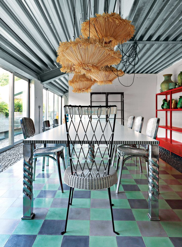 The Dining Room Her Tiger Raffia lamps for Crate & Barrel hang above the dining table. Its laminate top is by Ettore Sottsass for Abet Laminati, and the twisted metal legs are from her Crate & Barrel line.  Photo: Enrico Conti: