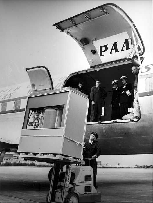 This is a 5MB hard drive from 1956 being lifted on to a plane