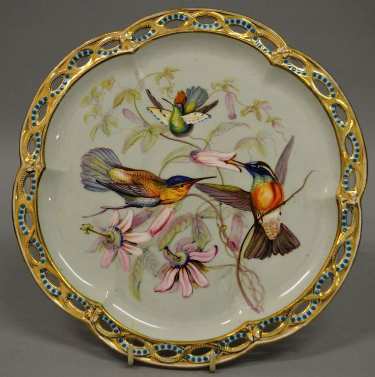 A MID 19TH CENTURY COALPORT PLATE painted with hummingbirds with turquoise jewelled & reticulated border.