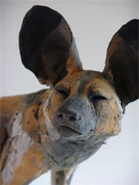 Nicola Theakston   Painted Dog No.1. Nichola's unique hand-built sculpture is usually fabricated without an armature, using thin slabs and small pieces of clay and built up like a puzzle or mosaic. The resulting fragility is integral to both the concept and aesthetic.