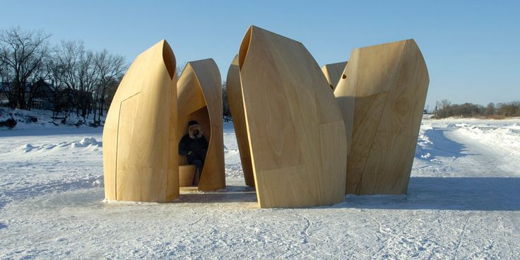 'winnipeg skating shelters' by patkau architects    these shelters made of flexible plywood, provide ice-skaters with relief from the harsh winter temperatures. standing with their backs to the wind,   the units develop a series of protective environments and interior spaces that accommodate several people at a time.
