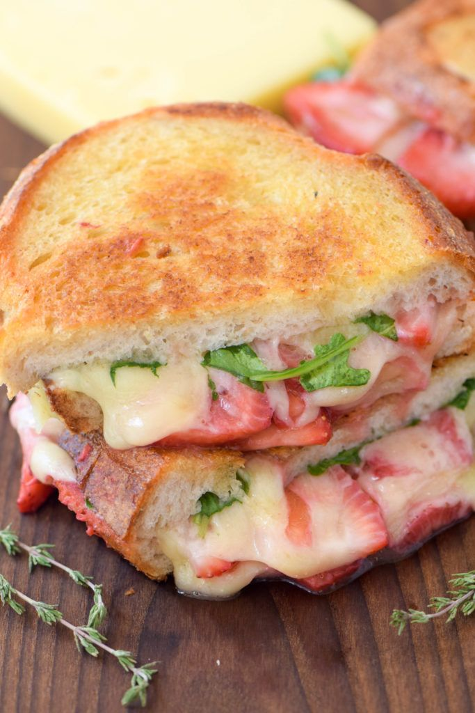 Celebrate National Grilled Cheese Month with a spring-inspired grilled cheese sandwich with arugula and pickled strawberries. #makeitmagnifique