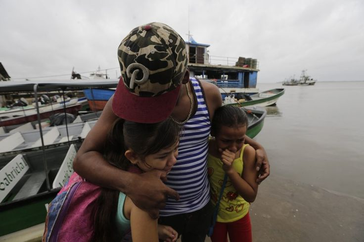 23 Nov 2016 Two children seek cover under the embrace of their father before Hurricane Otto arrives in Bluefields, Nicaragua. Inti Ocon/AFP #hurricaneotto #BluefieldsNicaragua