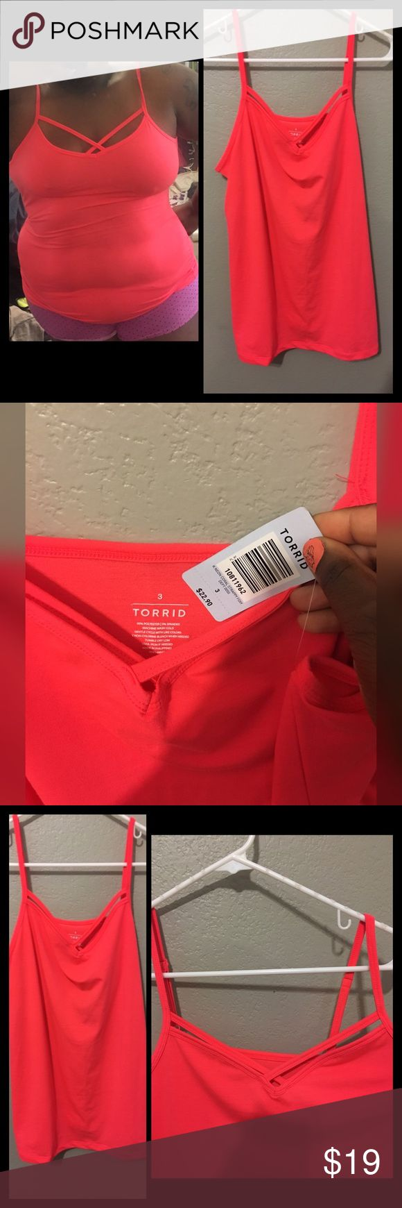 Torrid strappy cami size 3 Purchased from torrid size 3 soft stretchy material coral orange red neon color with strappy chest design brand new with tags never worn paid full price so Price Is Firm Sold out online torrid Tops Camisoles